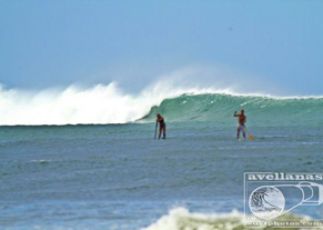 Couple SUP surfing costa rica vacation